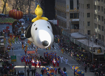 The Snoopy and Woodstock balloon float makes its way down 6th Avenue (Reuters)