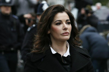 TV chef Nigella Lawson arrives at Isleworth Crown Court in west London (Reuters)