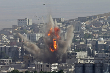 The aftermath of a US-led airstrike on IS targets in Kobane (AAP)