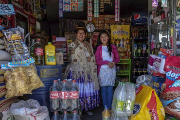 Lucia Mayta, 43, and her daughter Luz Cecilia, 12, inside their bodega in La Paz (Reuters)