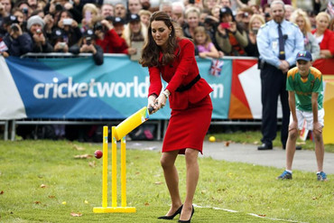 The Duchess takes a swing during a mini cricket match (Reuters)