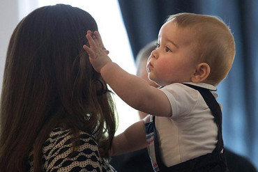 Kate holds her son Prince George at the playda