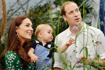 The most recent photo of Prince George with his parents, as they look at butterflies (Press Association)